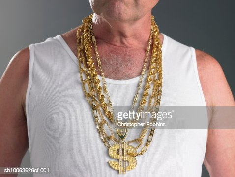 Goldkette dollar  Senior Man Wearing Tank Top And Gold Chains With Dollar Sign Mid ...