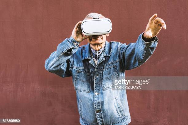 Senior man wearing virtual reality glasses