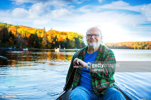 Senior man with a canoe in Algonquin Park - Canada