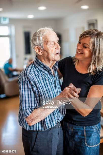 Senior Man with a Caregiver in an Elderly Daycare Center