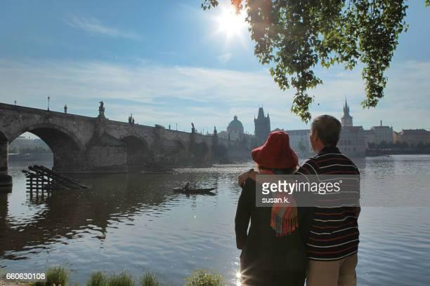 Senior man with arm around his wife enjoying beautiful morning view.