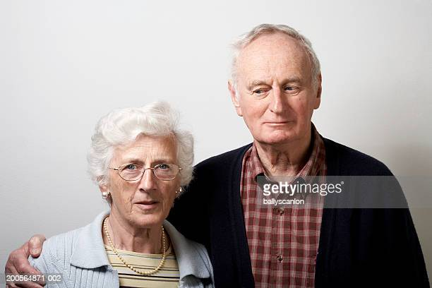 Senior man with arm around senior woman, portrait