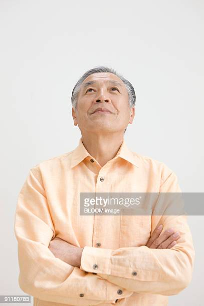 Senior man with arms folded, portrait