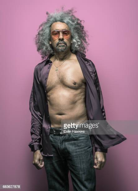 Senior Man with bear chest and sunglasses