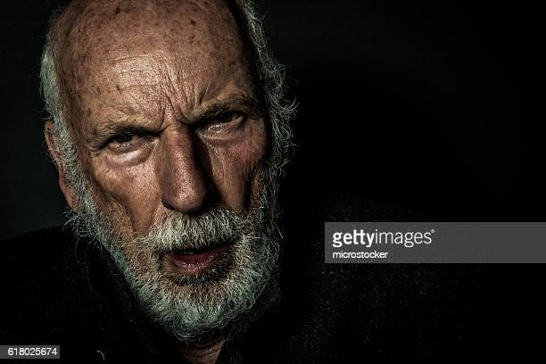 Senior man with beard with lonely and sad expression