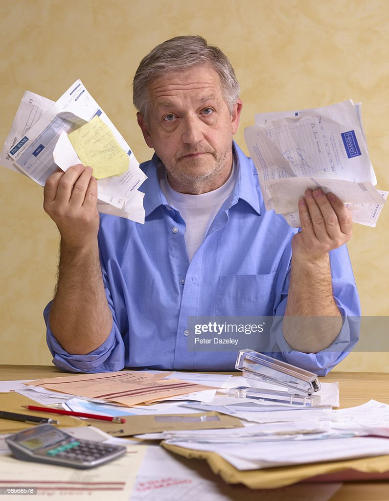 Senior man with bills : Stock Photo