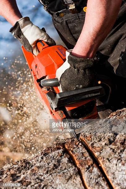 Senior man with chainsaw, close-up