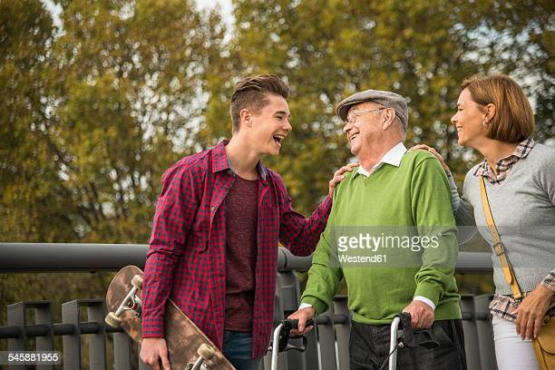 Senior man with daughter and grandson in park