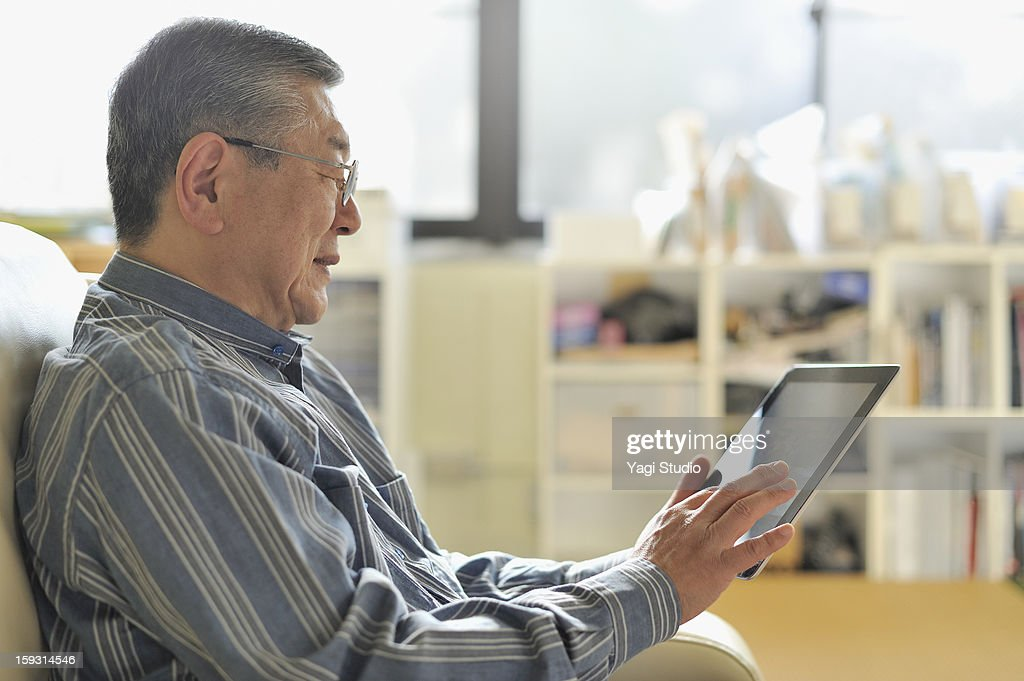 Senior man with digital tablet in Studio : Stock Photo