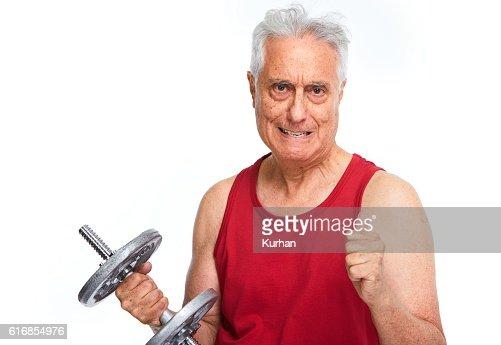 Senior man with dumbbell. : Stock Photo