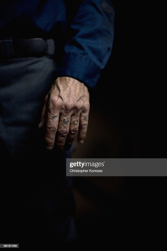 A senior man with 'fuck' tattooed on his knuckles