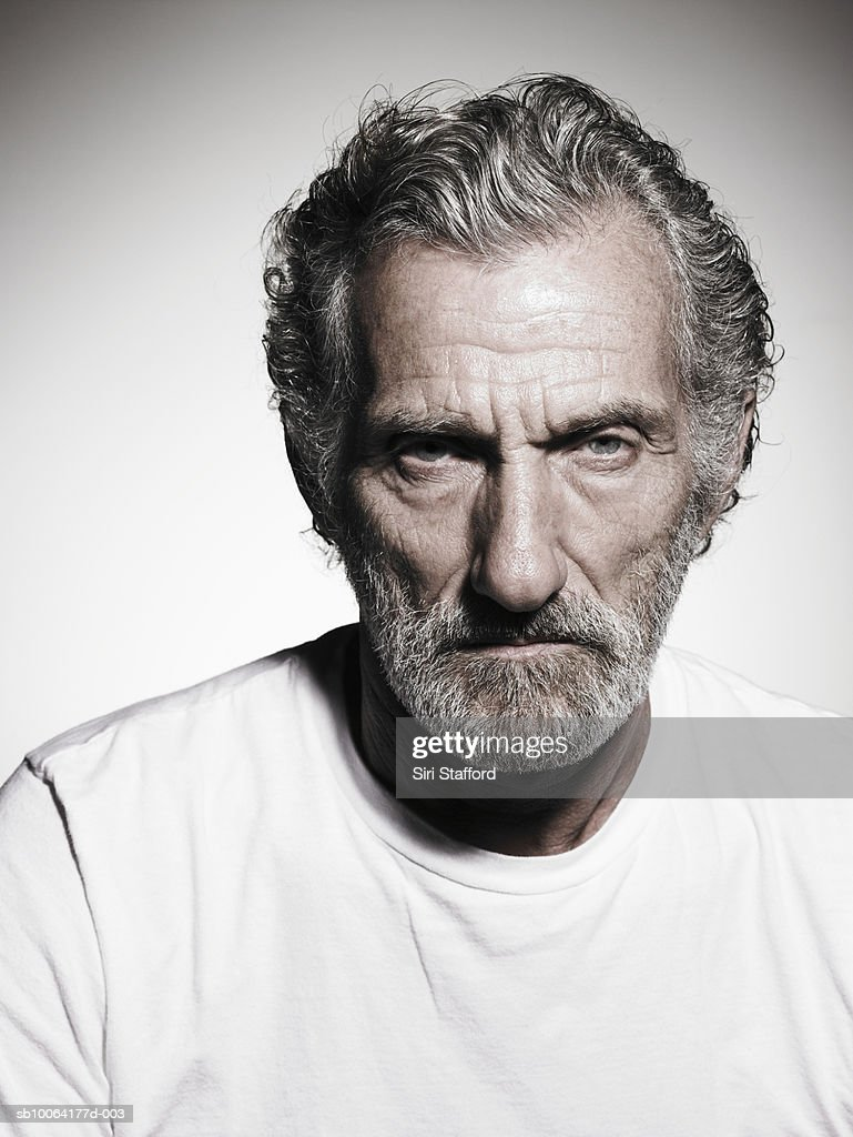 Senior man with grey hair and beard, portrait, close-up : Stock Photo