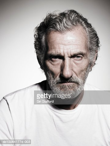 Senior man with grey hair and beard, portrait, close-up : Stock Photo