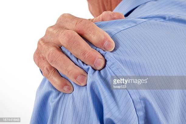 Senior man with hands rubbing shoulders and neck in pain