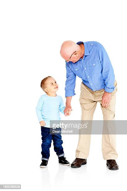 Senior man with his grandson on white background