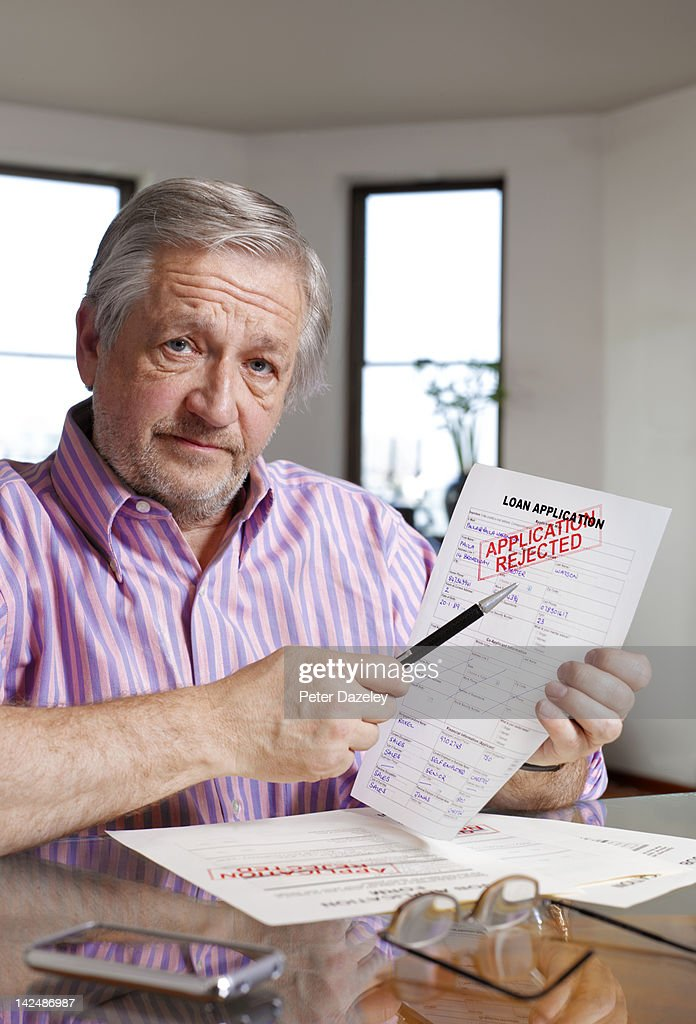 Senior man with loan application rejection