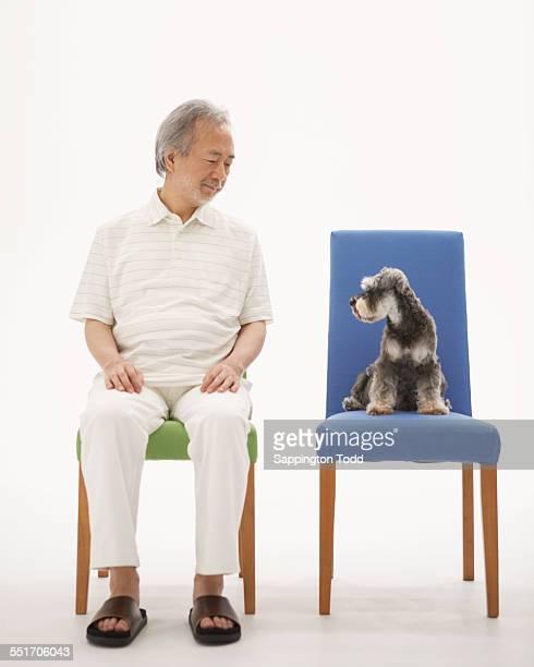 Senior Man With Miniature Schnauzer