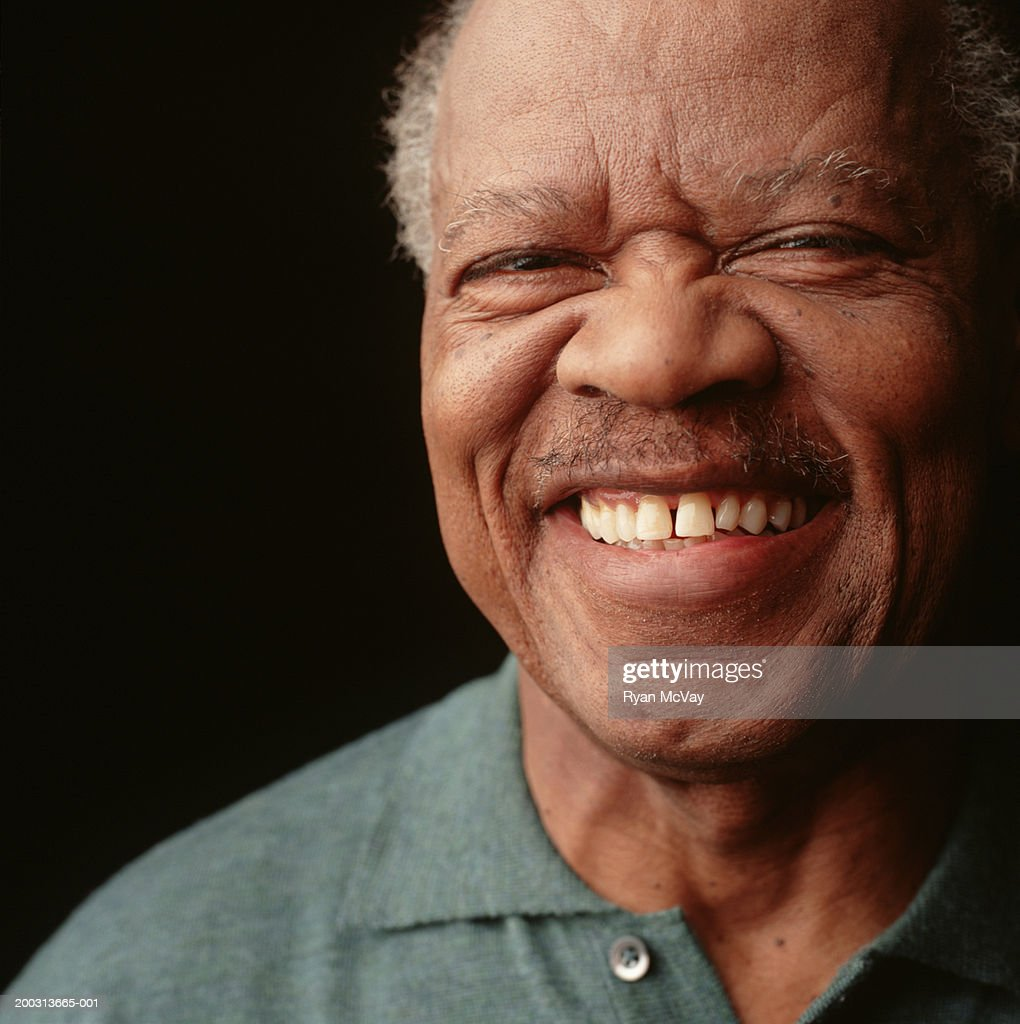 Senior man with moustache and toothy smile, posing in studio, close-up, portrait : Stock Photo