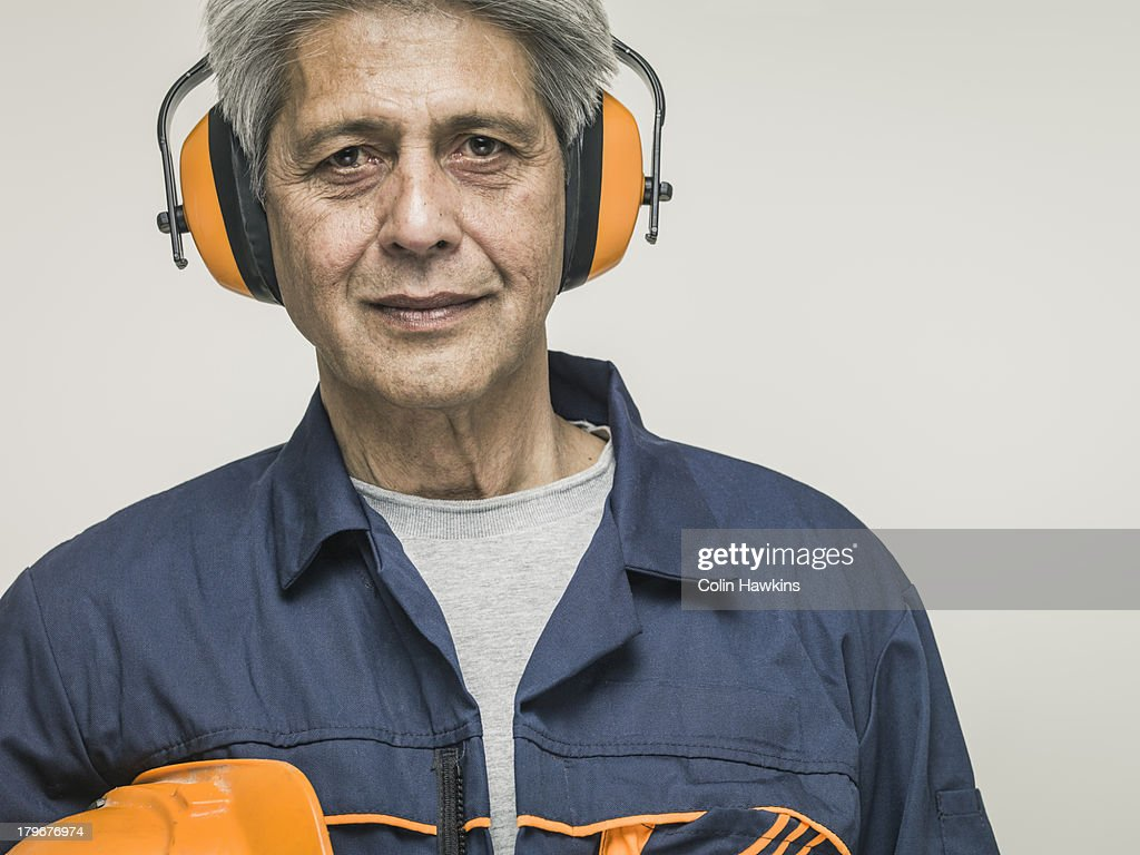 Senior man with protective clothing : Stock Photo