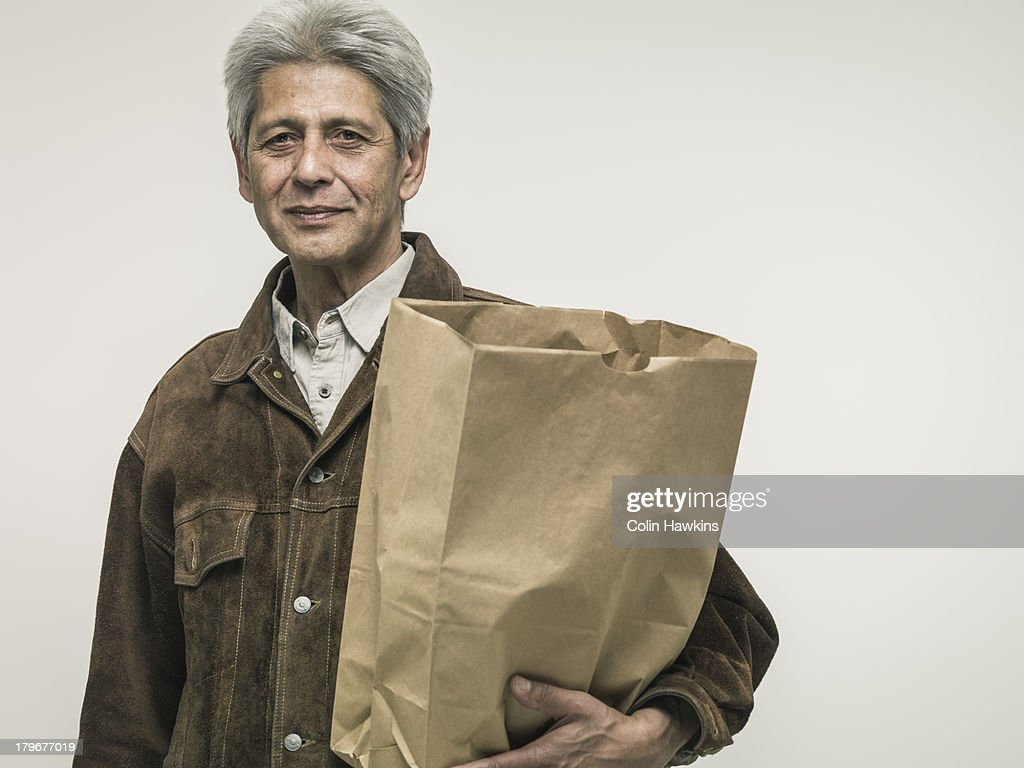 Senior man with shopping bag : Stock Photo
