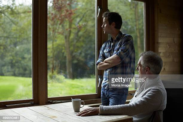 Senior man with son in cottage