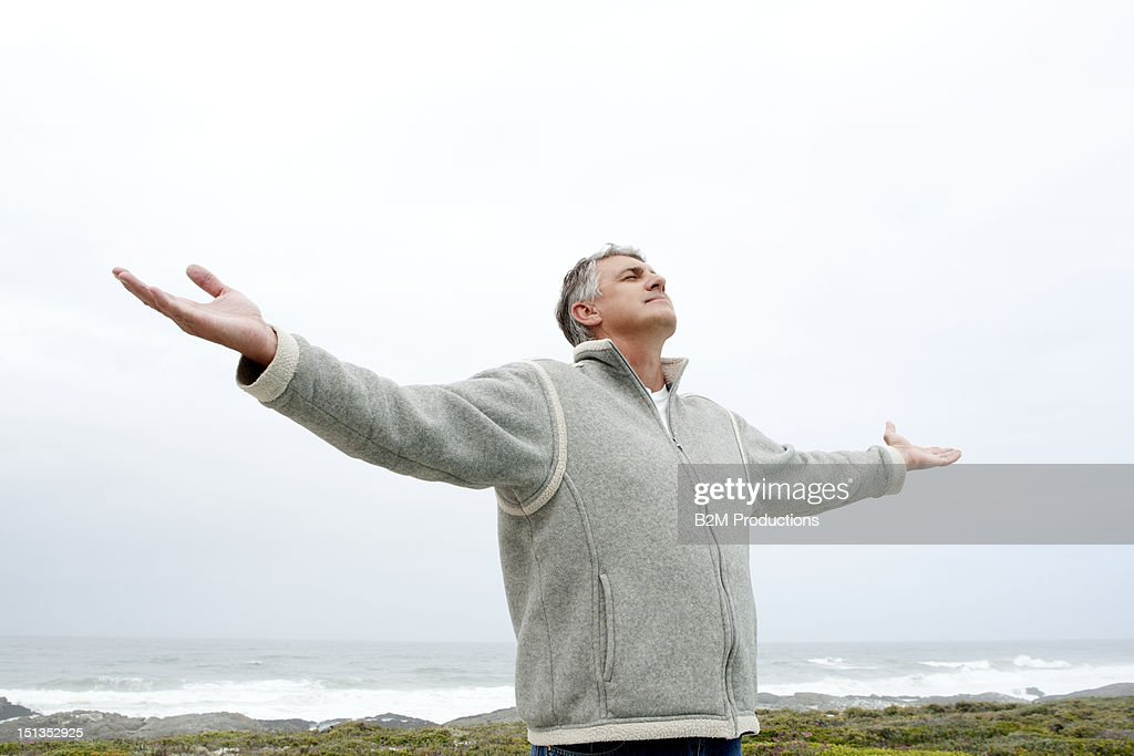 Senior Man With Stretched Arms At Beach : Stock Photo
