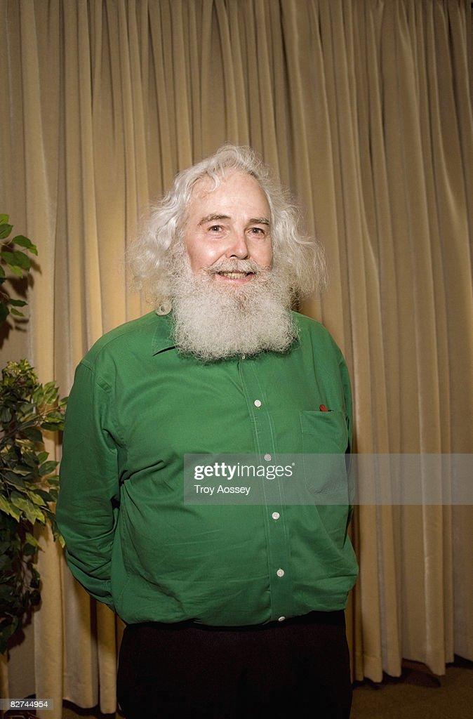 Senior man with unwieldy white hair smiling