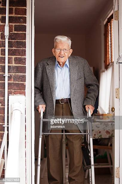 Senior Man With Walker On His Way Out The Door