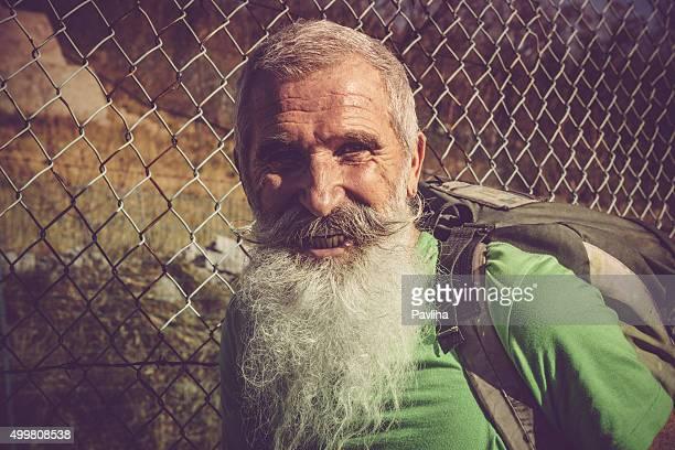 Senior Man with White Beard,portrait, mesh fence,Slovenia