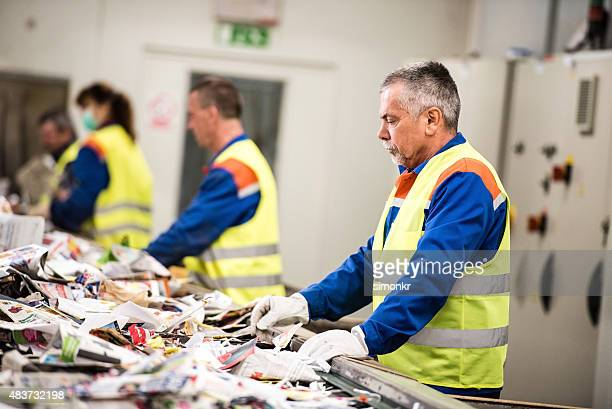 Senior man working at paper recycling plant