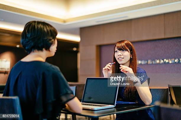 Senior manager interviewing job candidate in Japan