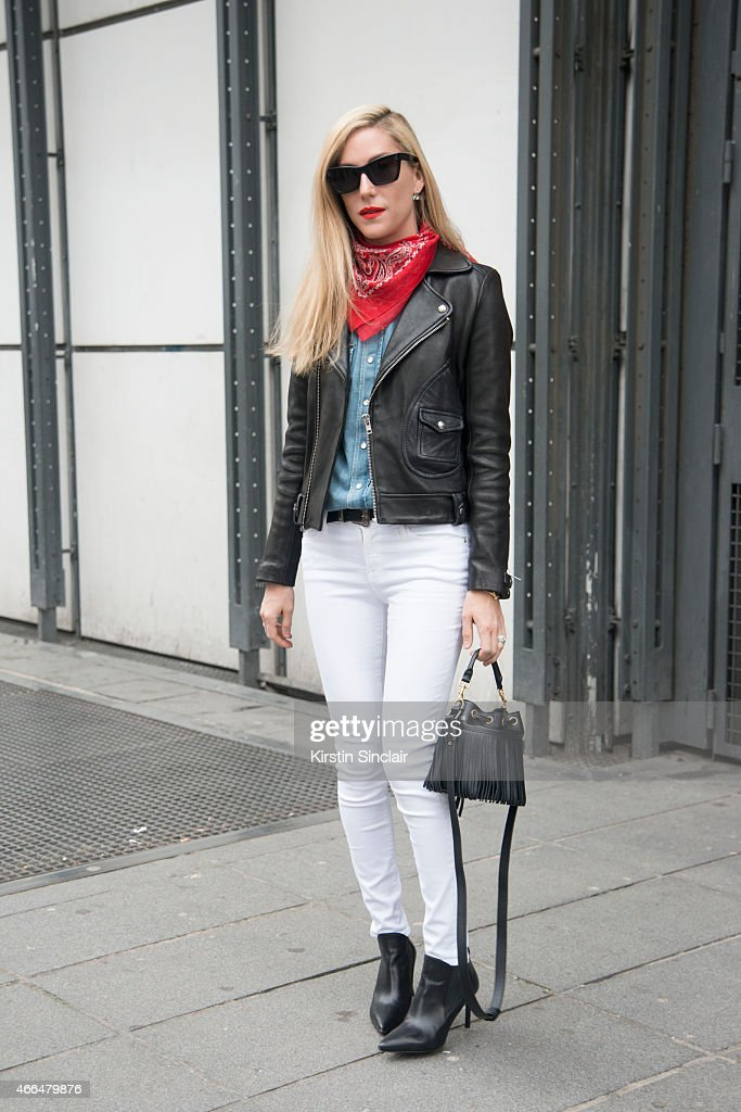 Senior Market Editor at Harperâs Bazaar USA Joanna Hillman wears Saint Laurent blouse bag and shoes Iro jacket Frame Denim jeans and Celine...