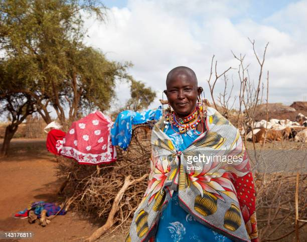 Senior masai woman in front of her village.