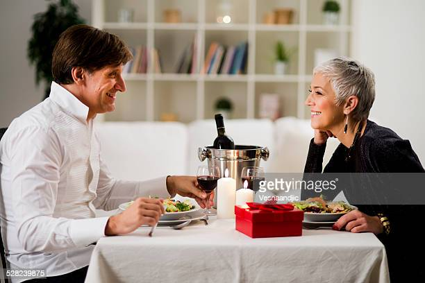 Senior- mature couple enjoying in romantic dinner