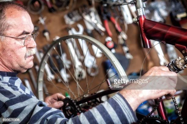Senior mechanic in his factory