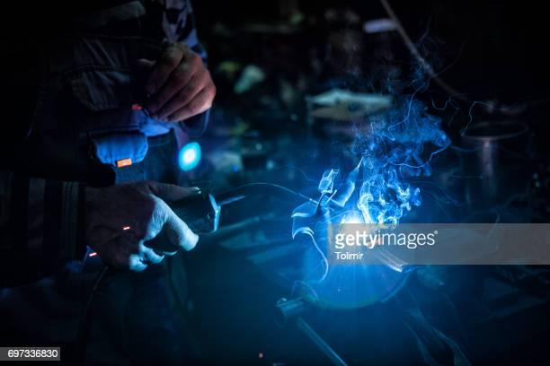 Senior mechanic welding