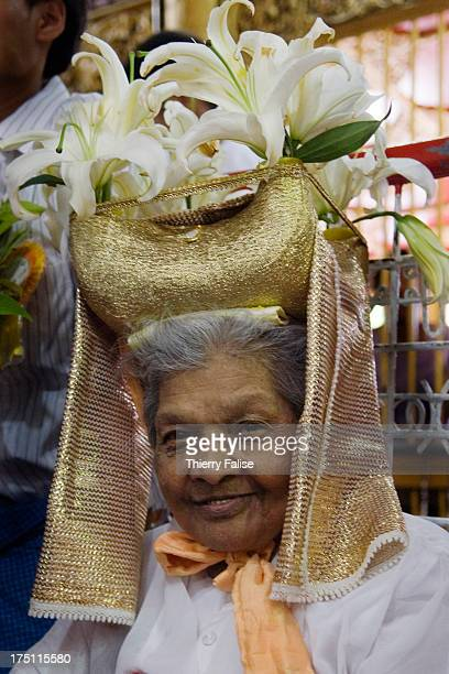 A senior medium wearing a ceremonial hat during a blessing ceremony at a shrine containing the statues of brothers Min Gyi and Min Lay the most...