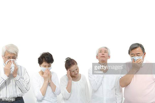 Senior men and women coughing feeling pain