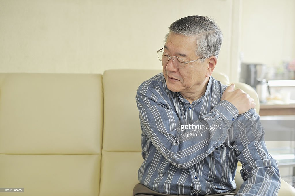Senior men are in pain a stiff neck : Stock Photo