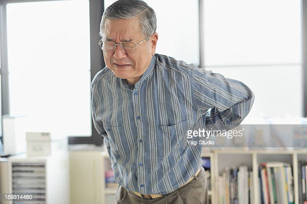 Senior men are in pain lower back pain