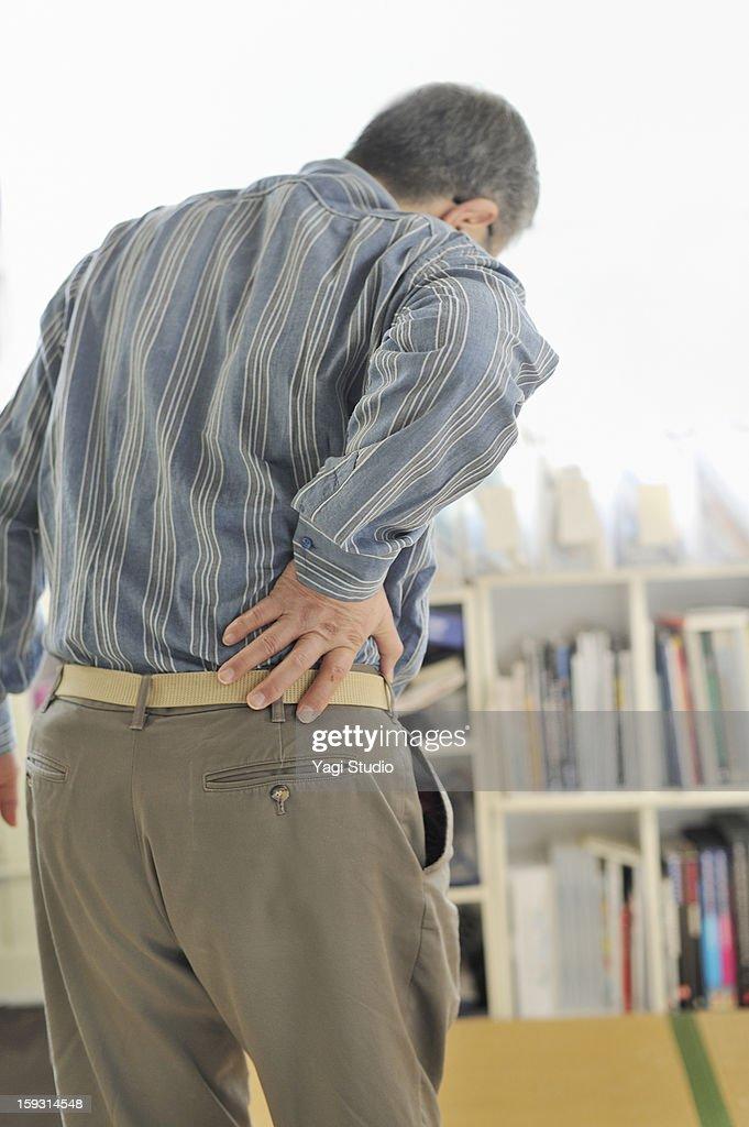 Senior men are in pain lower back pain : Stock Photo