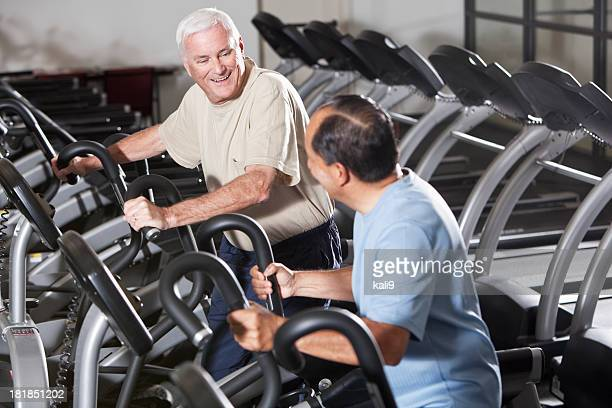 Senior men at health club on treadmills