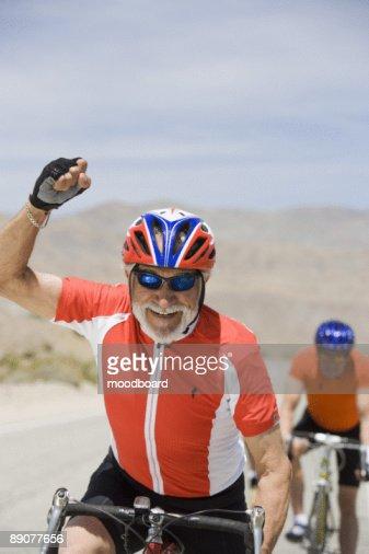 Senior men cycling : Stock Photo