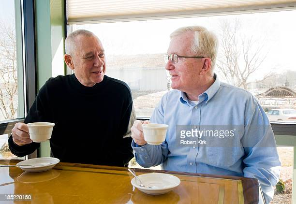 Senior Men Drinking Coffee in a Restaurant