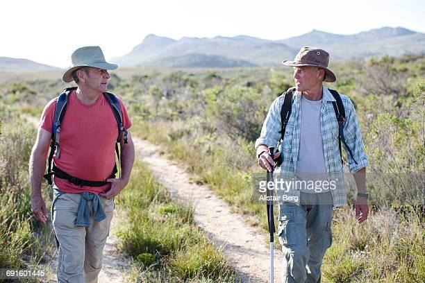 Senior men hiking outdoors