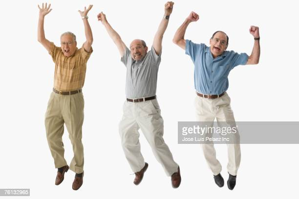 Senior men jumping