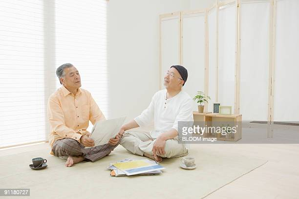 Senior men listening to music with eyes closed