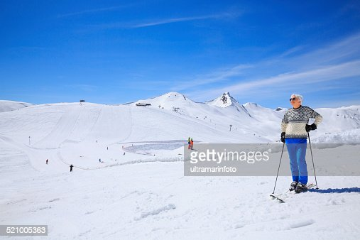 Senior men snow skier sunbathe on sunny ski resorts