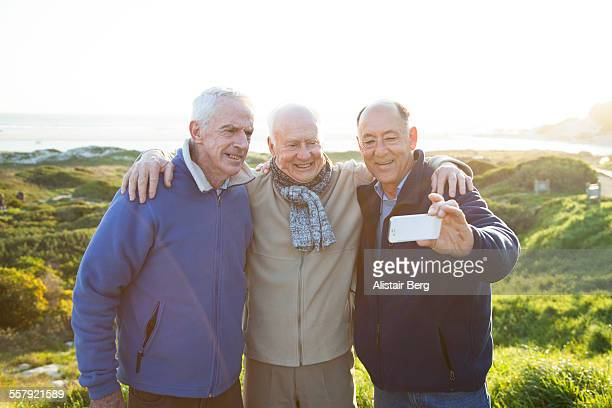 Senior men taking photo together