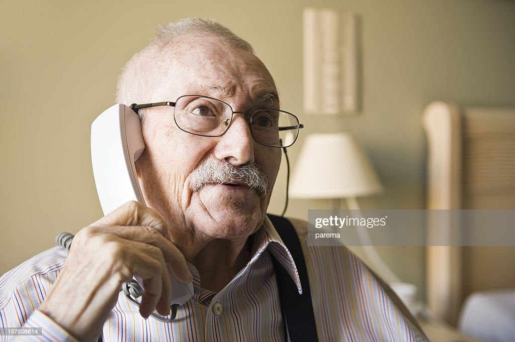 Senior men talking by phone. : Stock Photo